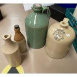 "A green glaze stoneware flaggon; a fawn stoneware flaggon ""Wm Radams Microbe Killer"" & two smaller"