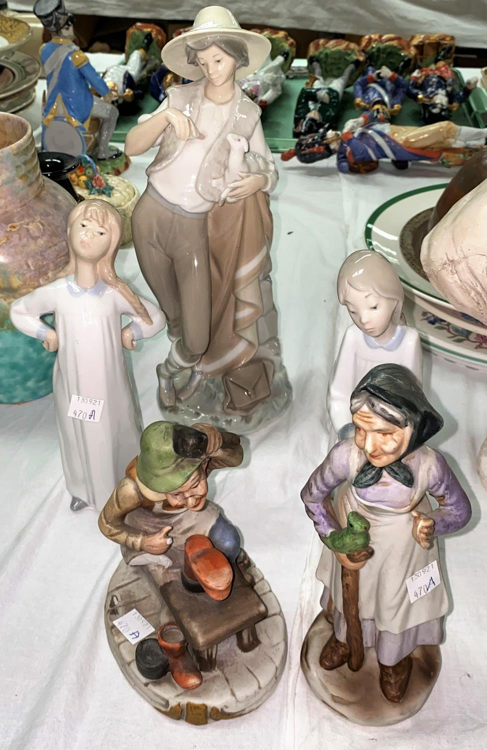 A Lladro figure of a Shepherd feeding a lamb & two other Lladro figures etc.