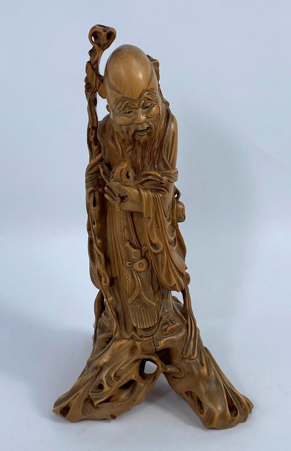 A Chinese carved wood figure of a sage, ht. 24cm