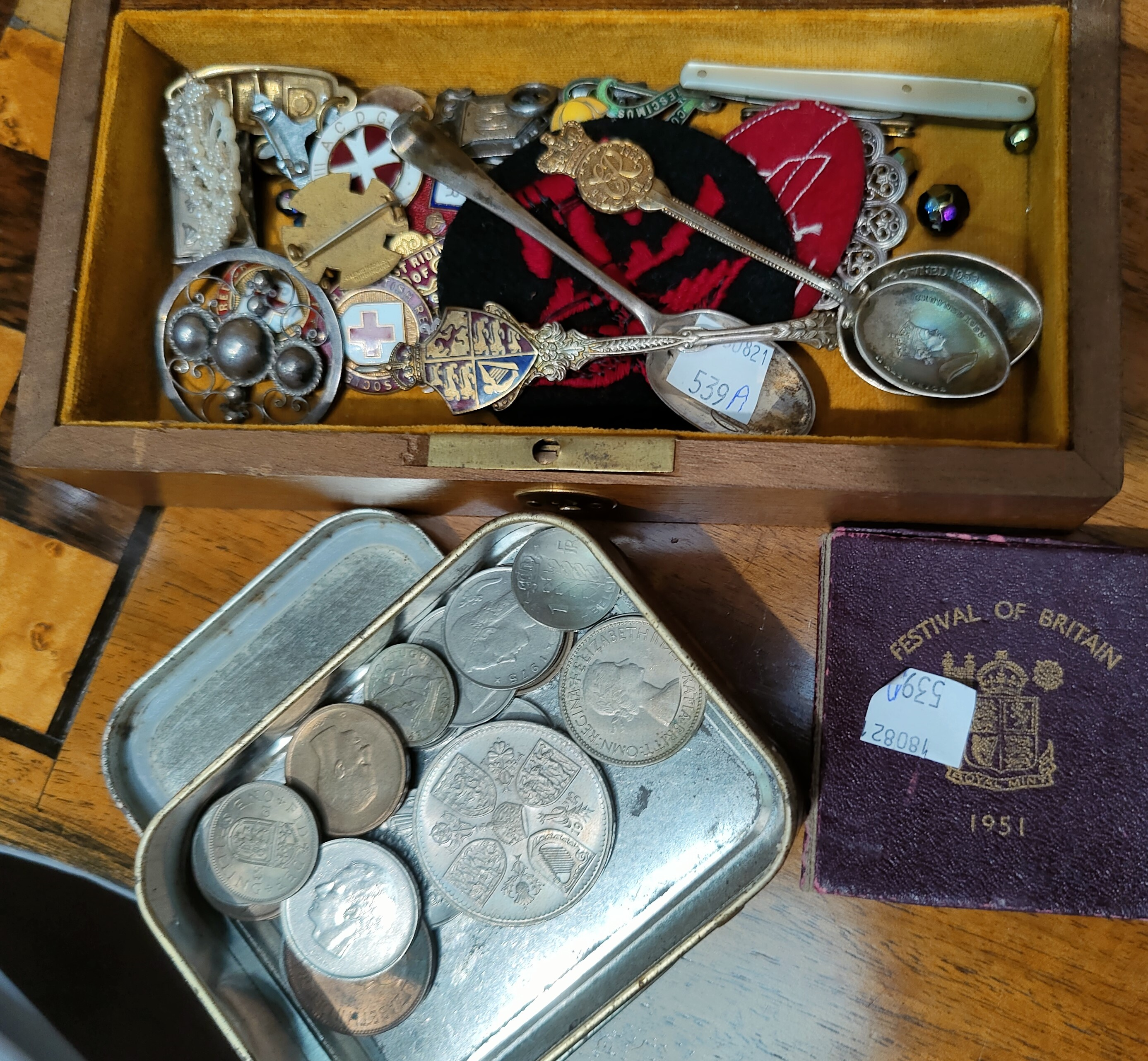 A selection of costume jewellery; enamel; badges; coins; etc.
