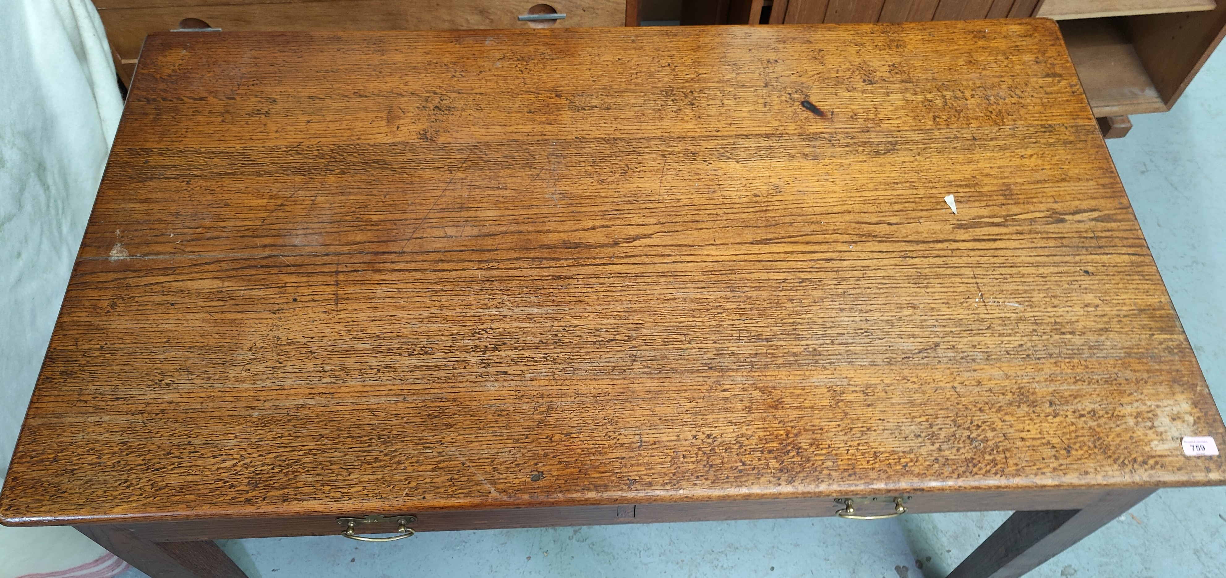 An early 20th century oak desk, possibly military, with crown G.R.V. stamped under, with two - Image 2 of 3
