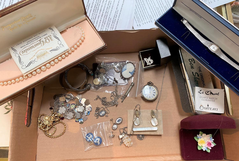 A hallmarked silver bracelet; a white metal charm bracelet; a white metal fob watch; white metal and