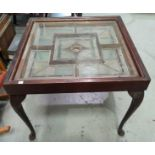 A stained glass top coffee table