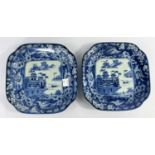 2 Japanese blue and white squared dishes with central mountain scene and borders with mythical