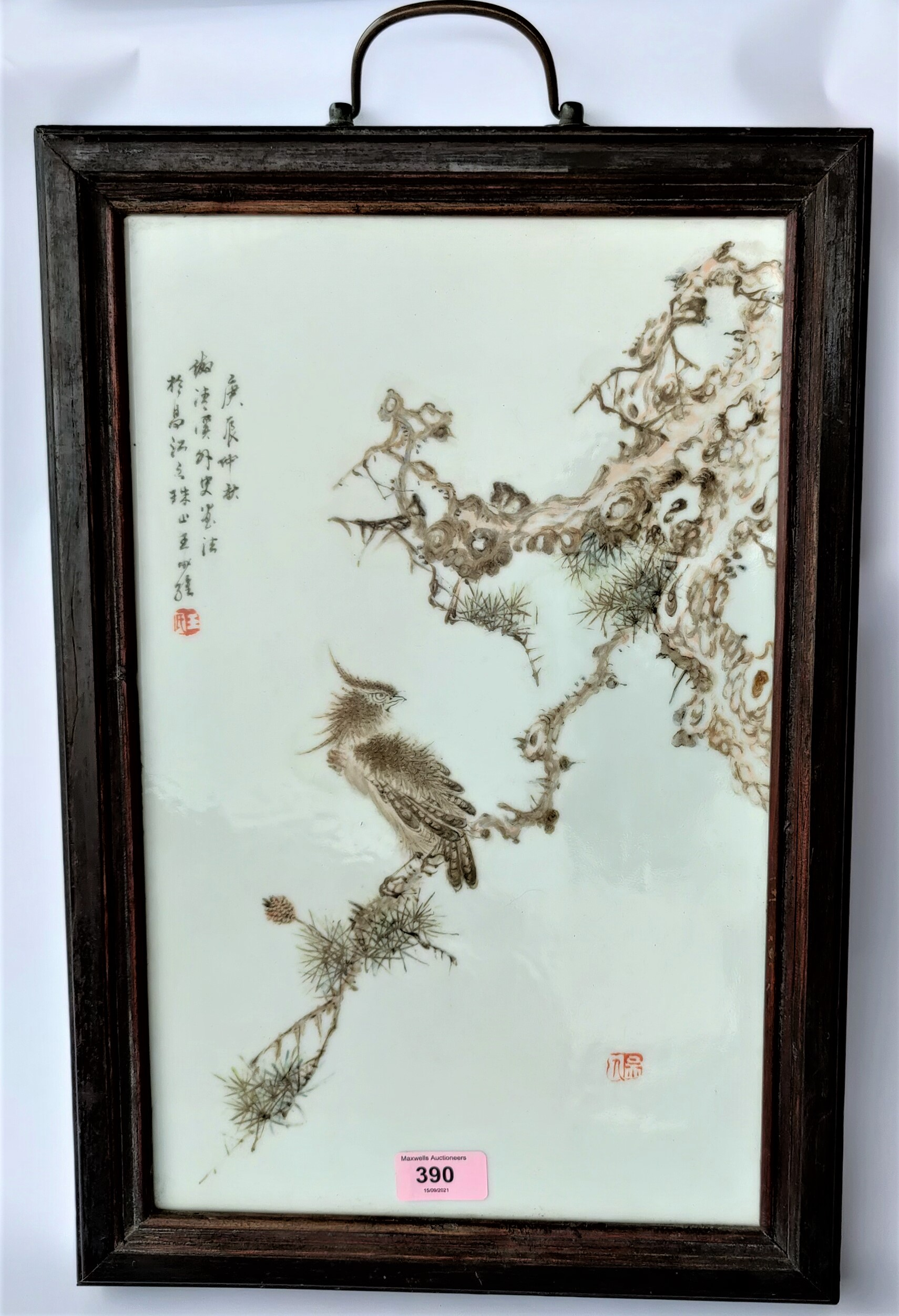 A Chinese Republic Period handpained ceramic tile of a bird on a branch, wooden frame, with