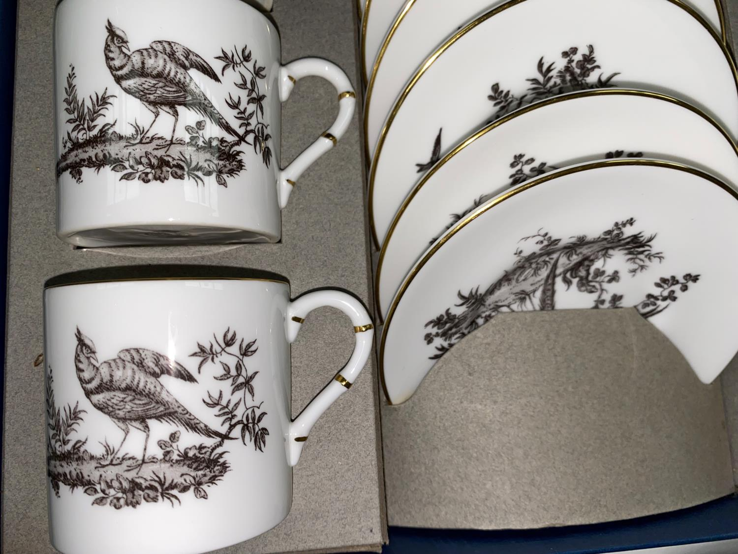 A Royal Worcester black and white coffee service of 12 pieces, boxed; a floral coffee service; cut - Image 2 of 5
