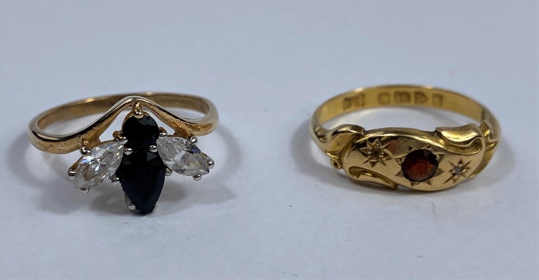 An 18 carat hallmarked gold Victorian style dress ring set garnet, 2 gm; a 9 carat hallmarked gold