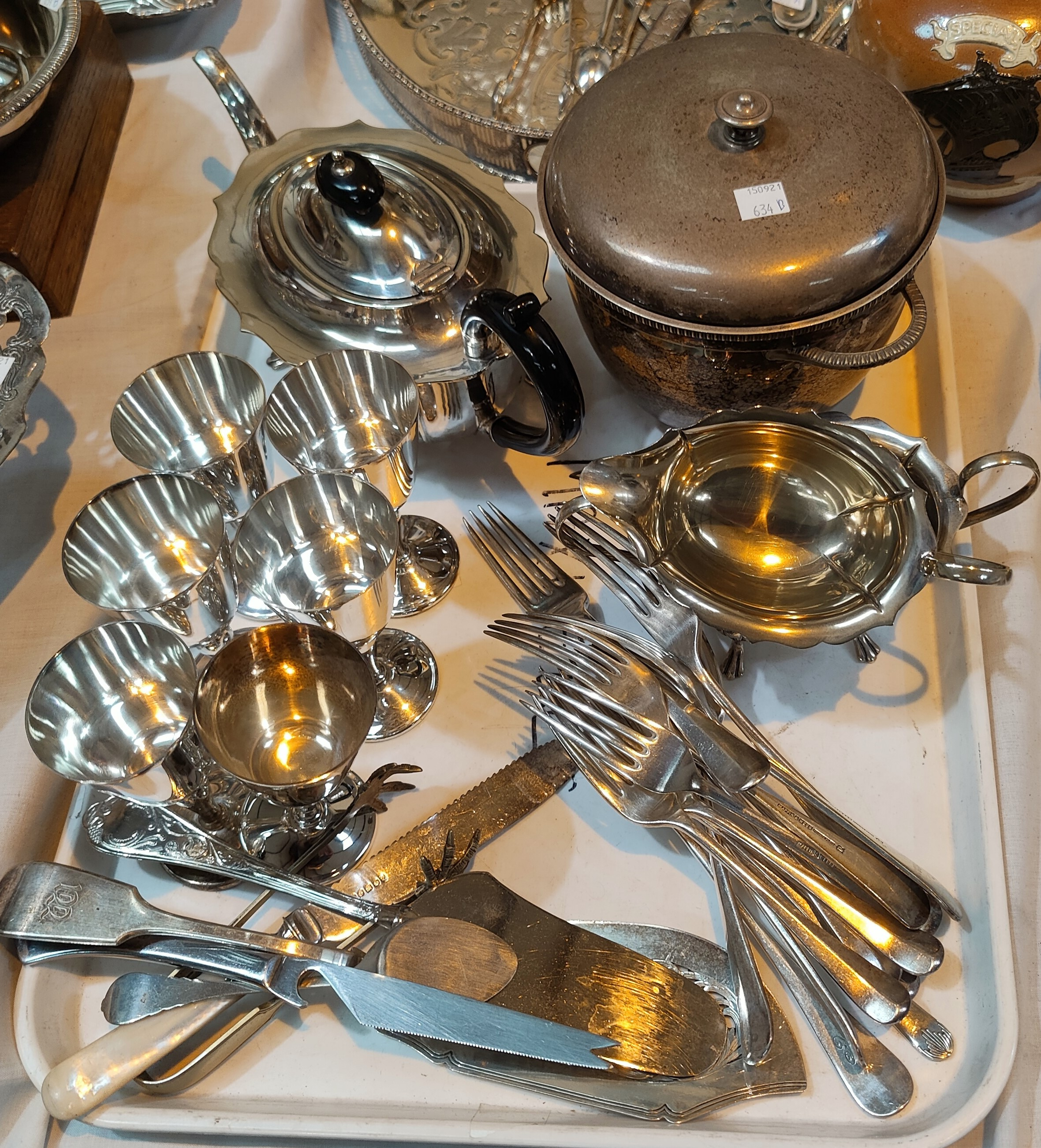 A selection of silver plated cuttlery; a silver plated ice bucket etc.