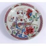 A small Chinese famille rose dish with polychrome decoration of a bird on a branch surrounded by