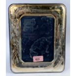 A silver mounted cushion photo frame with wheat straw decoration. 26 x 21cm