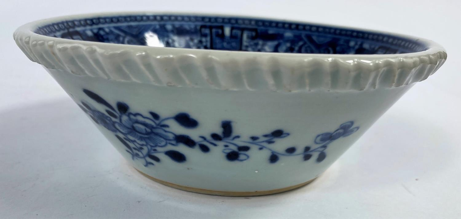 An 18th century Chinese blue and white porcelain bowl with pie crust rim decorated with antiques and - Image 2 of 5