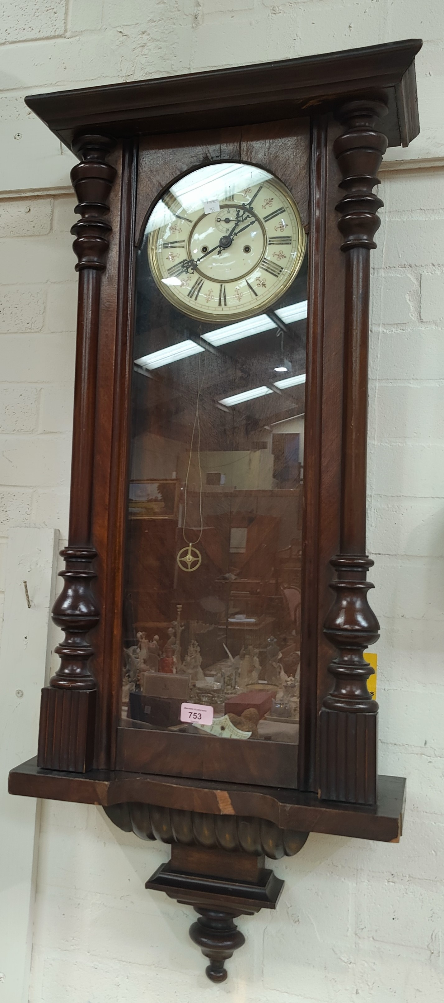 A 19th century Vienna wall clock with double weight driven movement (no crest)