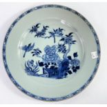 A 19th century Chinese blue and white plate with central panel of birds in trees, d. 28cm