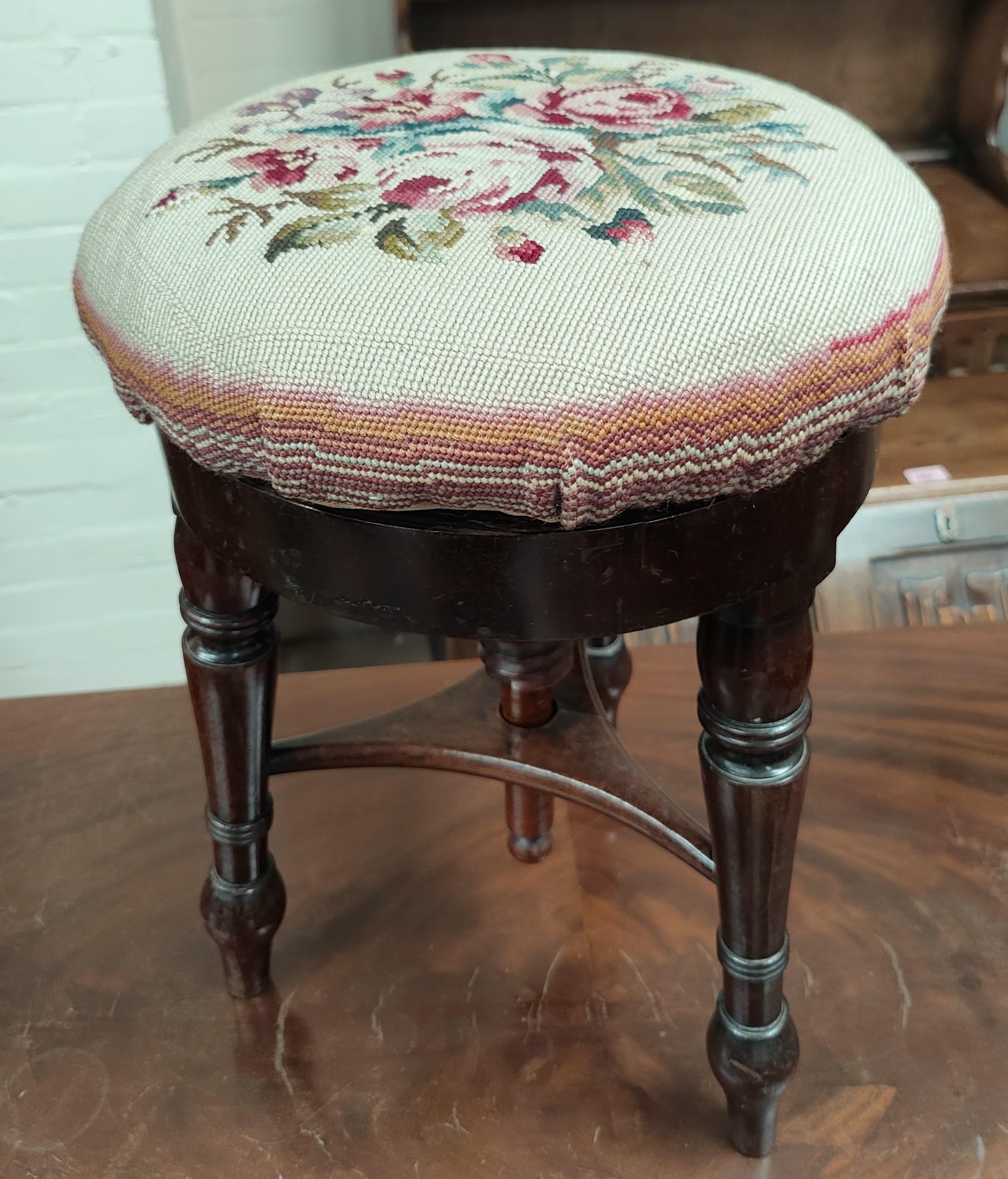 A Victorian mahogany revolving piano stool; an Edwardian walnut Sutherland table