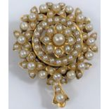 A Victorian yellow metal brooch/pendant set seed pearls, unmarked, tests as 15 carat, 11.2 gm