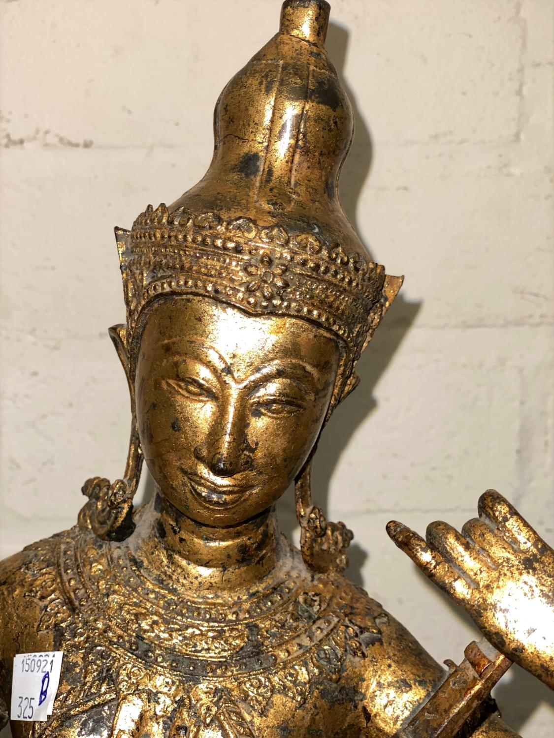 An Asian bronze figure of a seated Buddha playing a musical instrument with gilt highlights and - Image 2 of 4