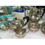 A silver plated 4 piece tea set in the Georgian oval style with embossed decoration