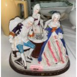 A Dresden style china two bottle ink stand, the cover in the form of figures playing chess, length