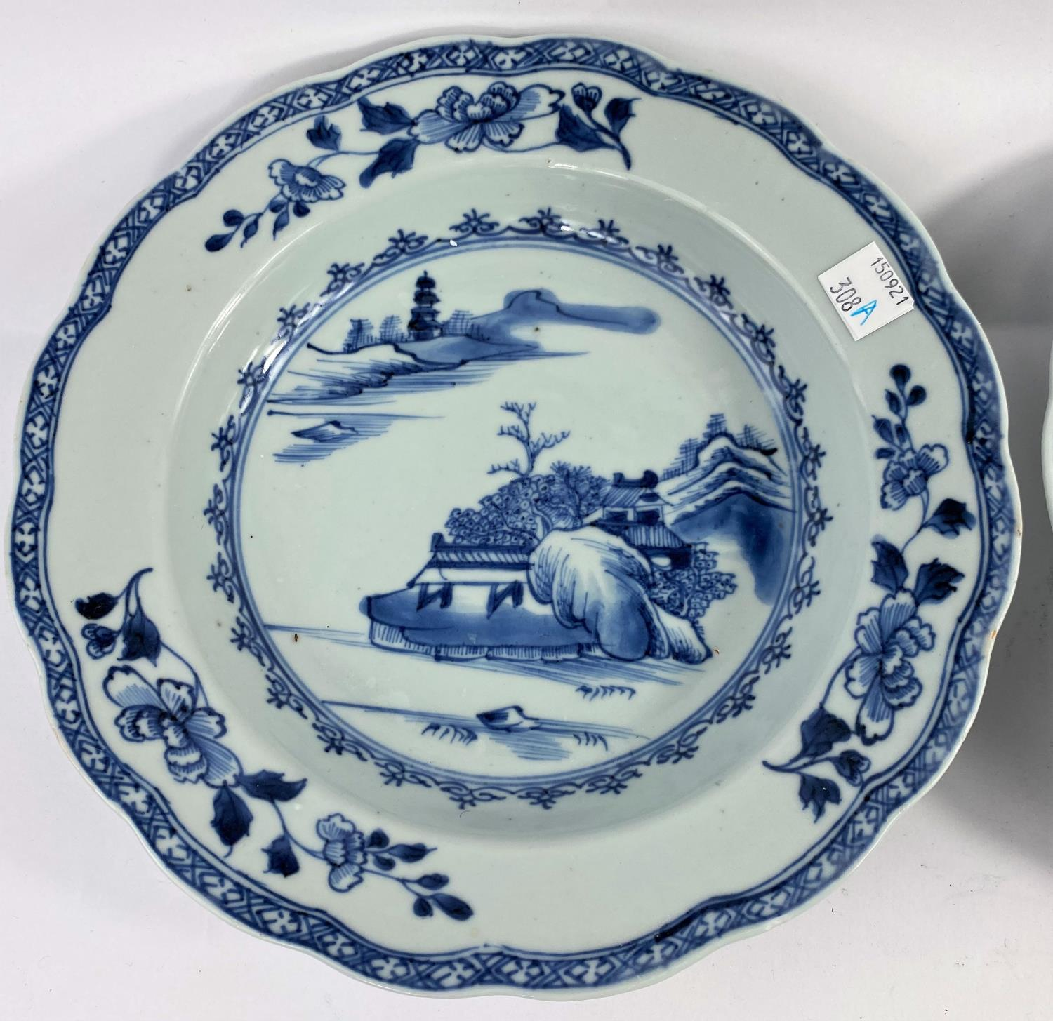 A pair of 18th century Chinese blue and white shallow dishes with traditional mountain scenes, - Image 2 of 6