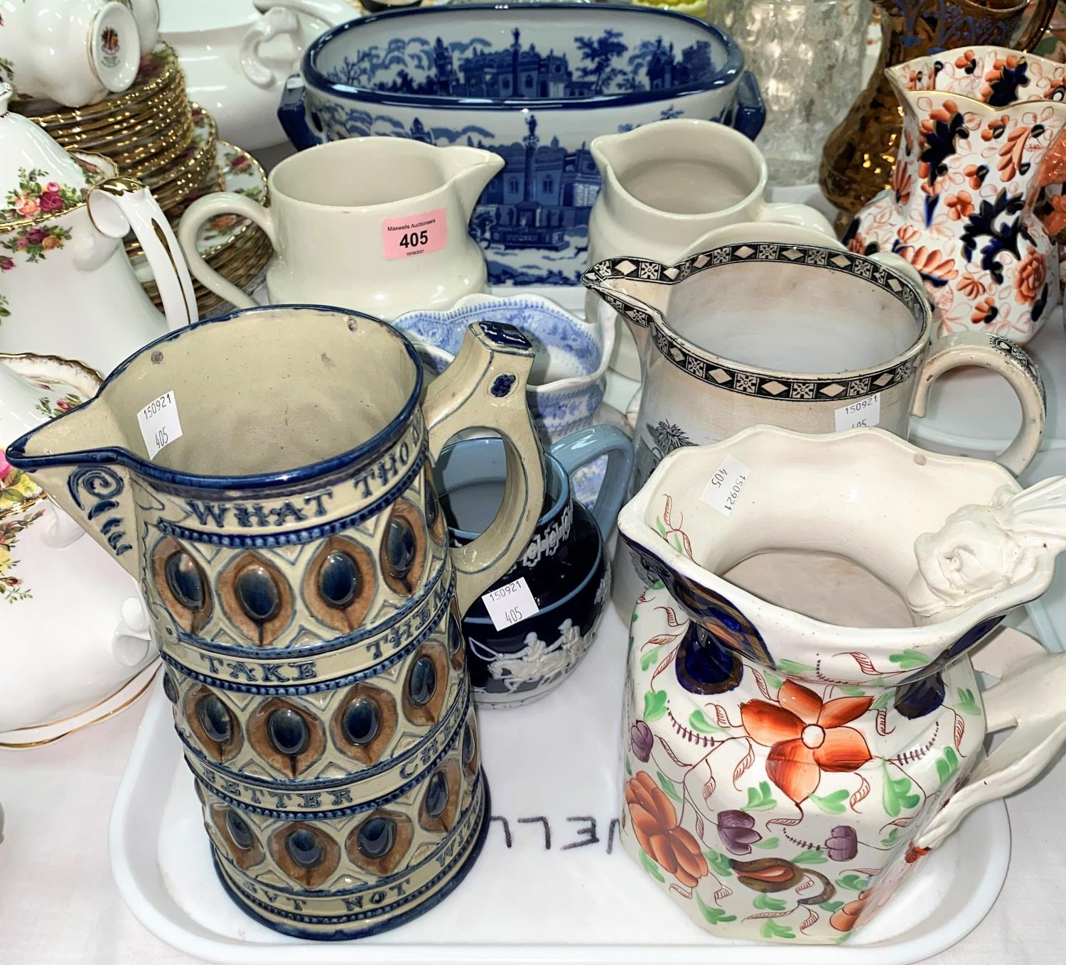 A collection of Victorian and later jugs; a modern blue & white footbath