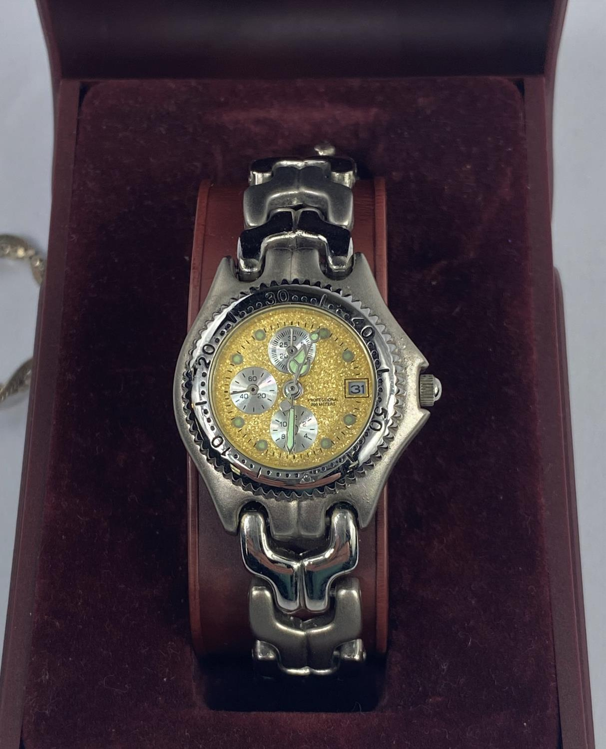 A lady's stainless steel wristwatch with a gilt face & 3 secondary dials; a smoky quarts pendant - Image 2 of 3