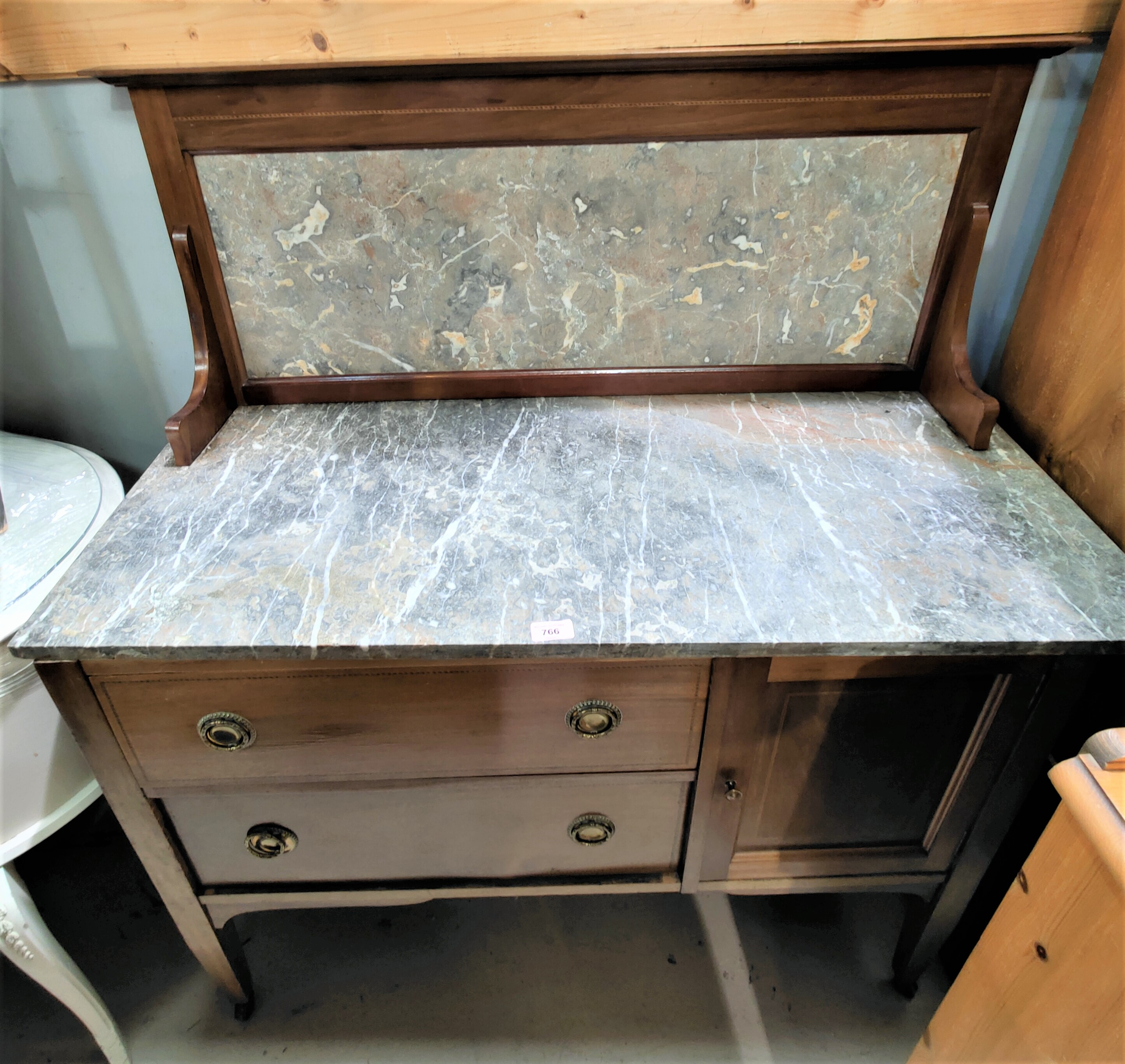 An Edwardian inlaid mahogany washstand with marble top and back, cupboard and 2 drawers