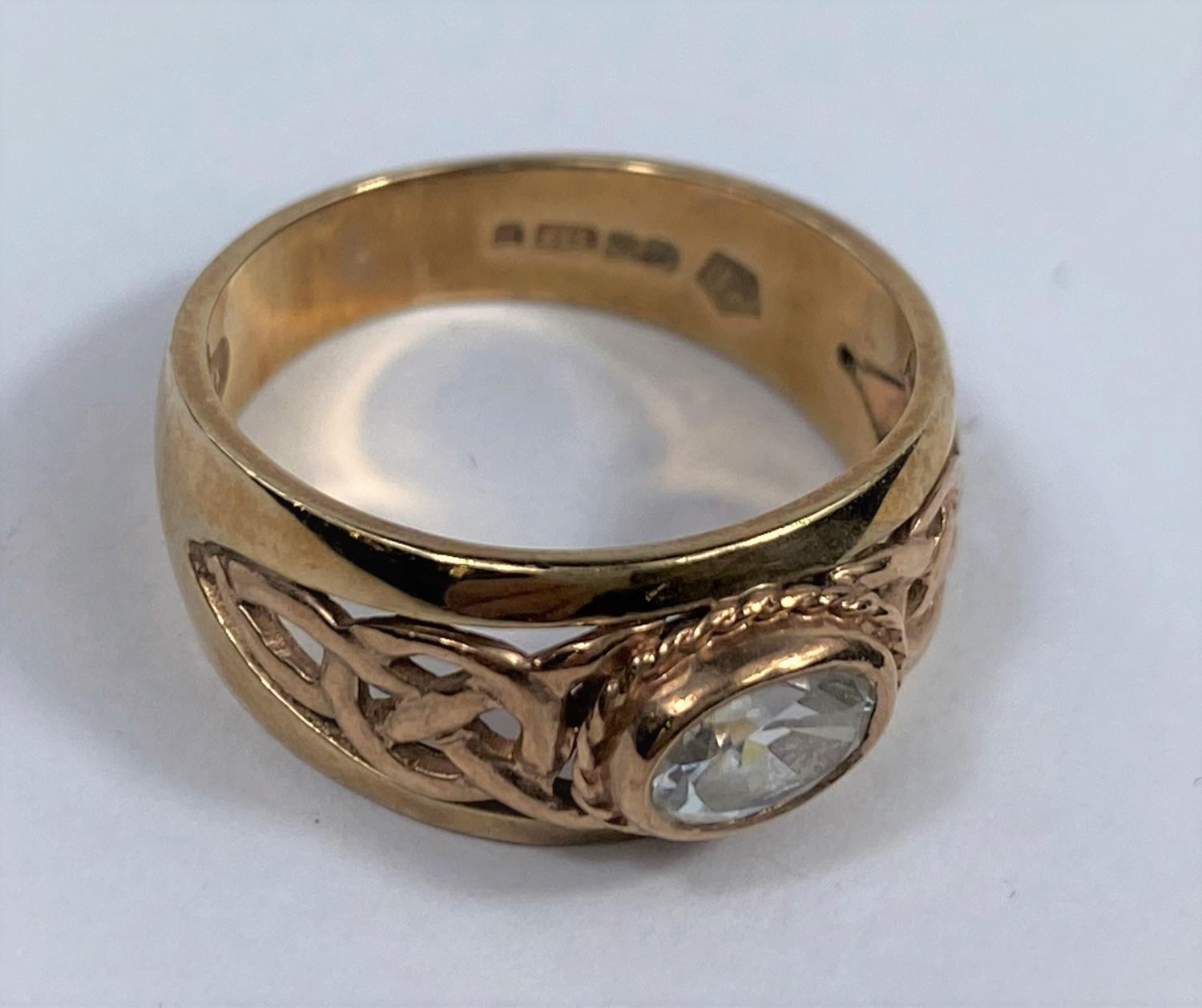 A 9 carat hallmarked gold period style ring set clear oval stone, the split shank with pierced - Image 2 of 5