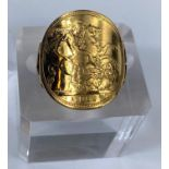 A ring formed and shaped from a 1965 sovereign, shank unmarked, 9.5 gm gross weight