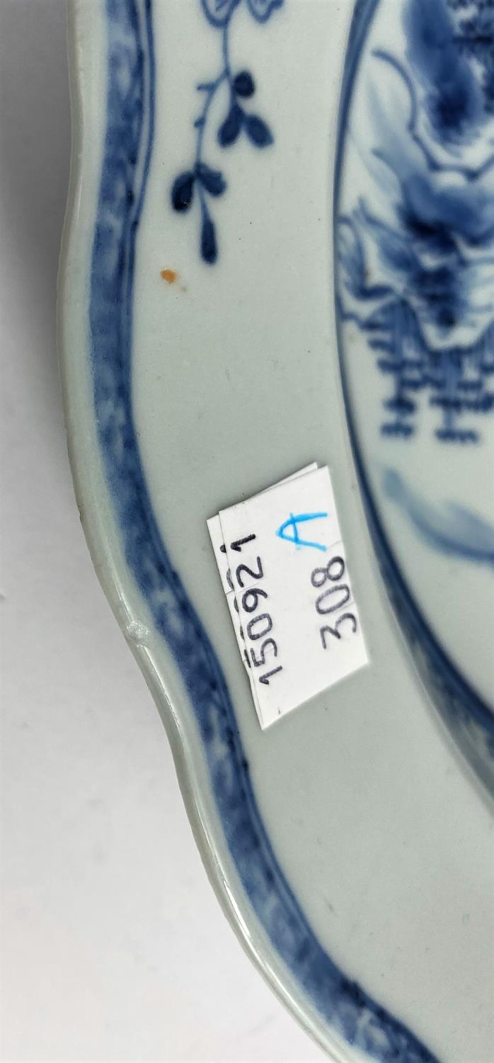 A pair of 18th century Chinese blue and white shallow dishes with traditional mountain scenes, - Image 5 of 6