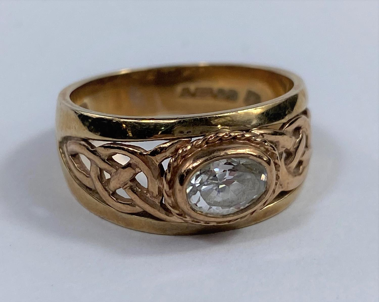 A 9 carat hallmarked gold period style ring set clear oval stone, the split shank with pierced - Image 5 of 5