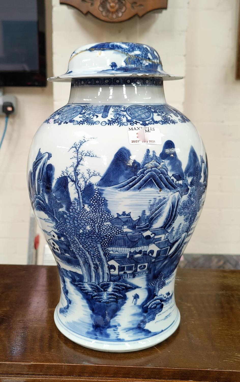 A large18th century Chinese Qianlong period blue and white inverted baluster lidded vase with