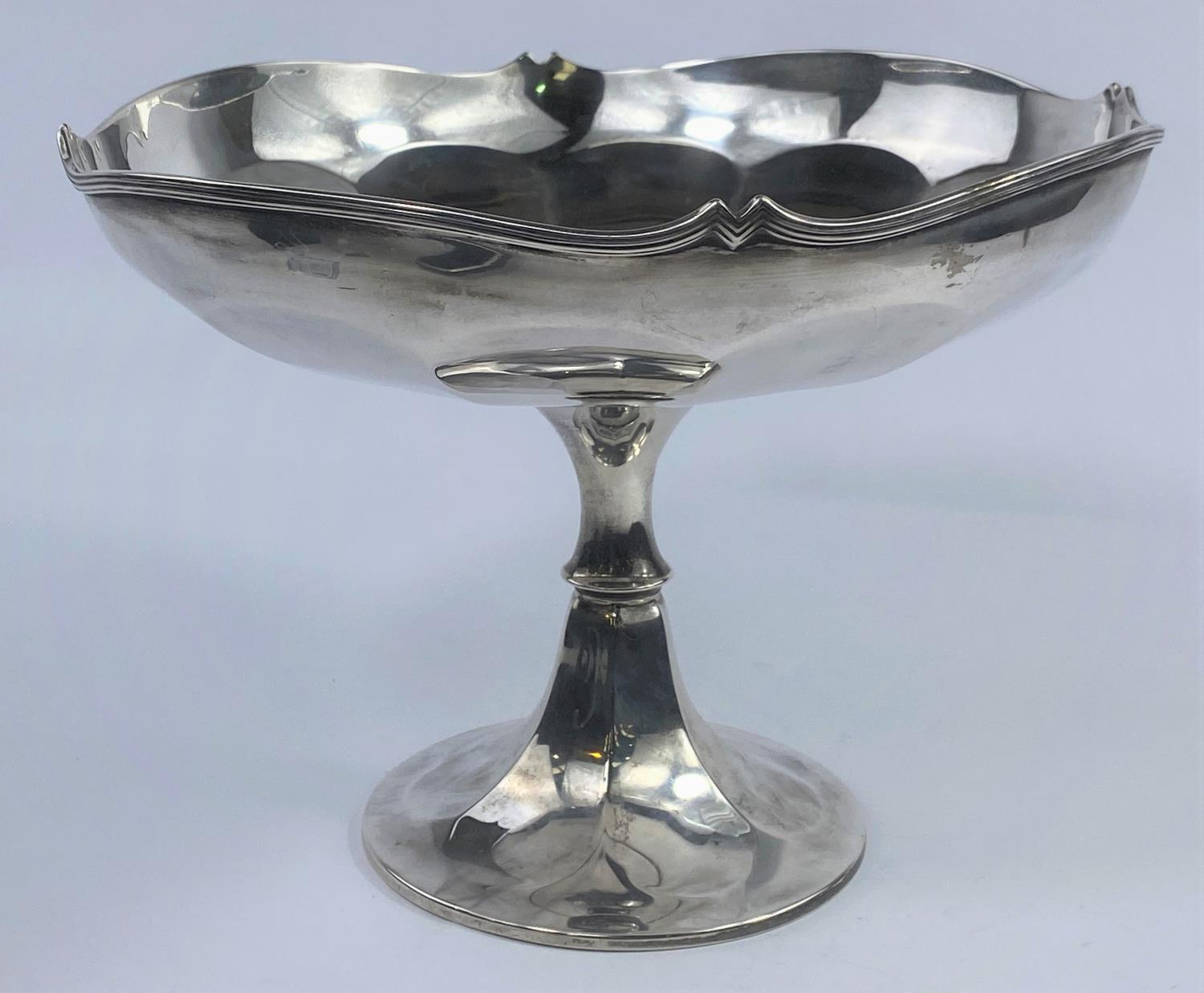 A hallmarked silver circular ribbed dish on pedestal with flared foot, Birmingham 1918, bears