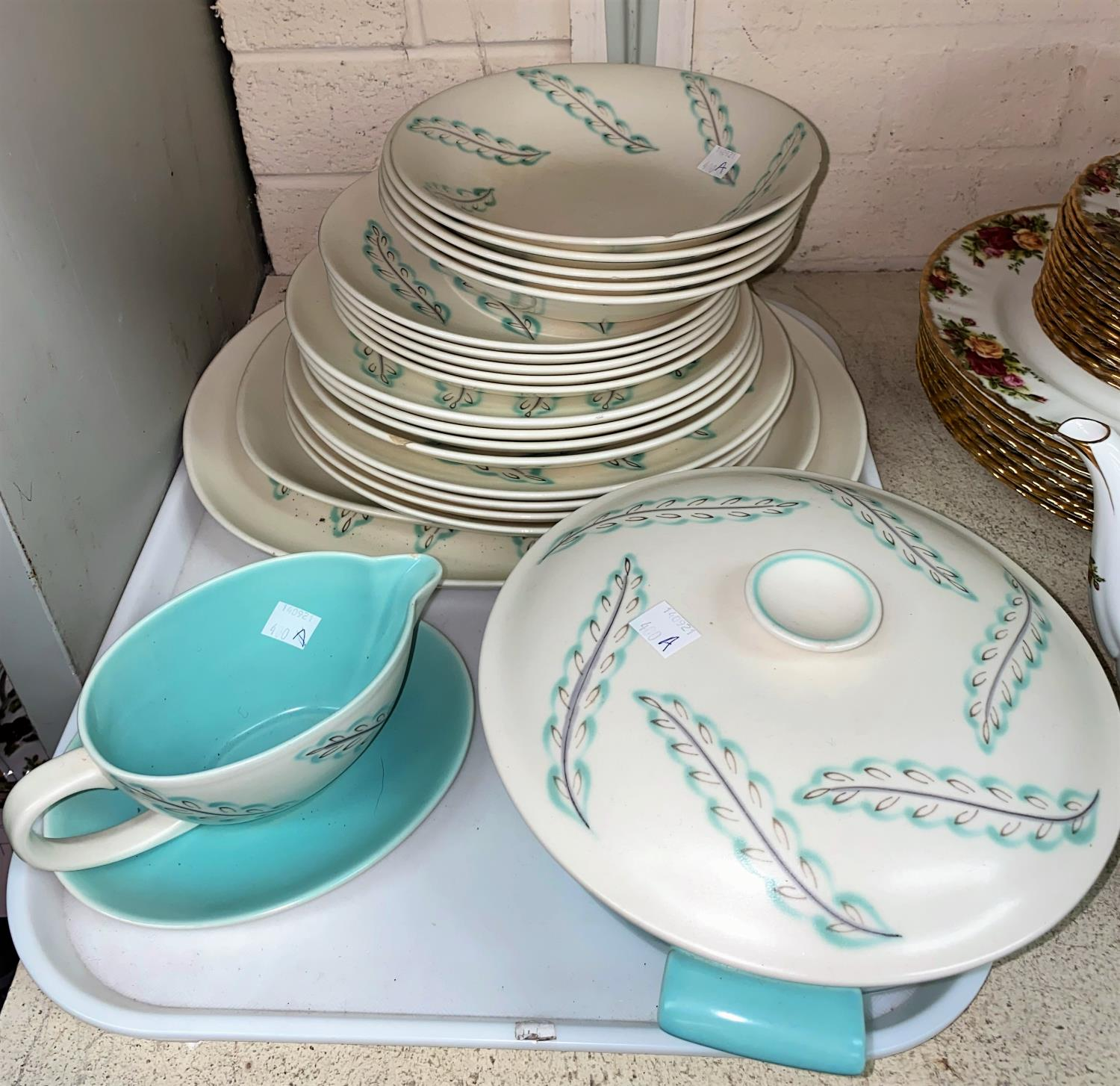 A Poole pottery part dinner service, 1950's hand painted free form design, 22 pieces