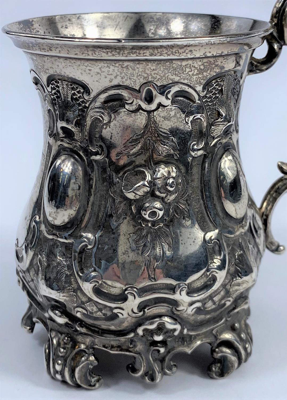 A hallmarked silver Victorian half pint mug on scroll feet, ornate decoration, inscribed, London - Image 2 of 5
