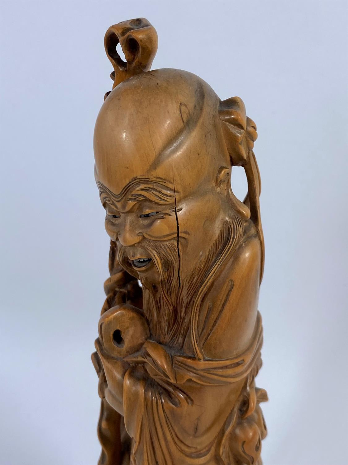 A Chinese carved wood figure of a sage, ht. 24cm - Image 2 of 4