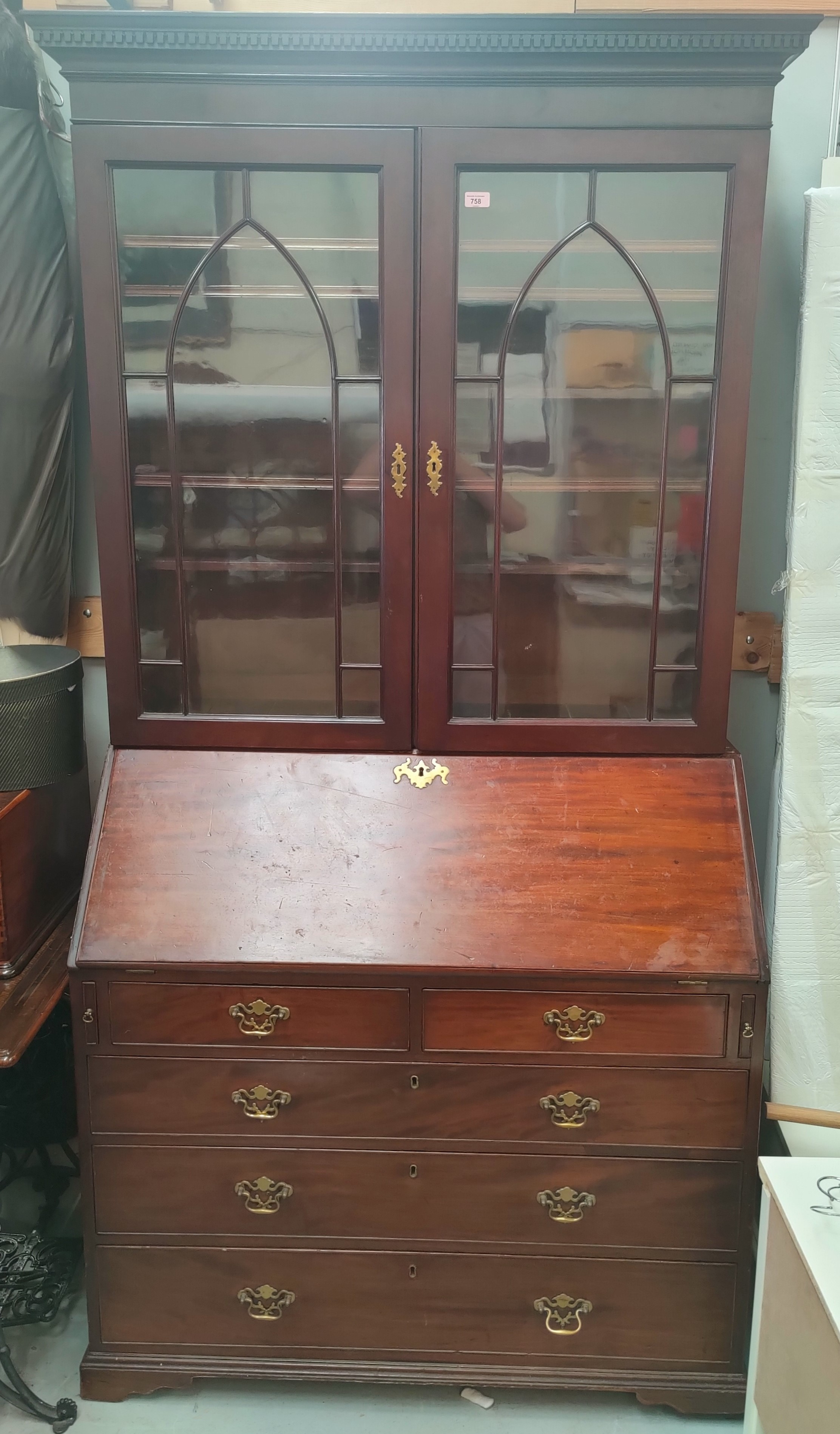 A Georgian bureau bookcase with glazed double doors to the top with arched decoration, four