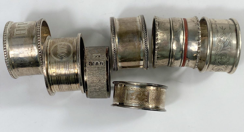 7 hallmarked silver napkin rings, various dates, 5.25oz