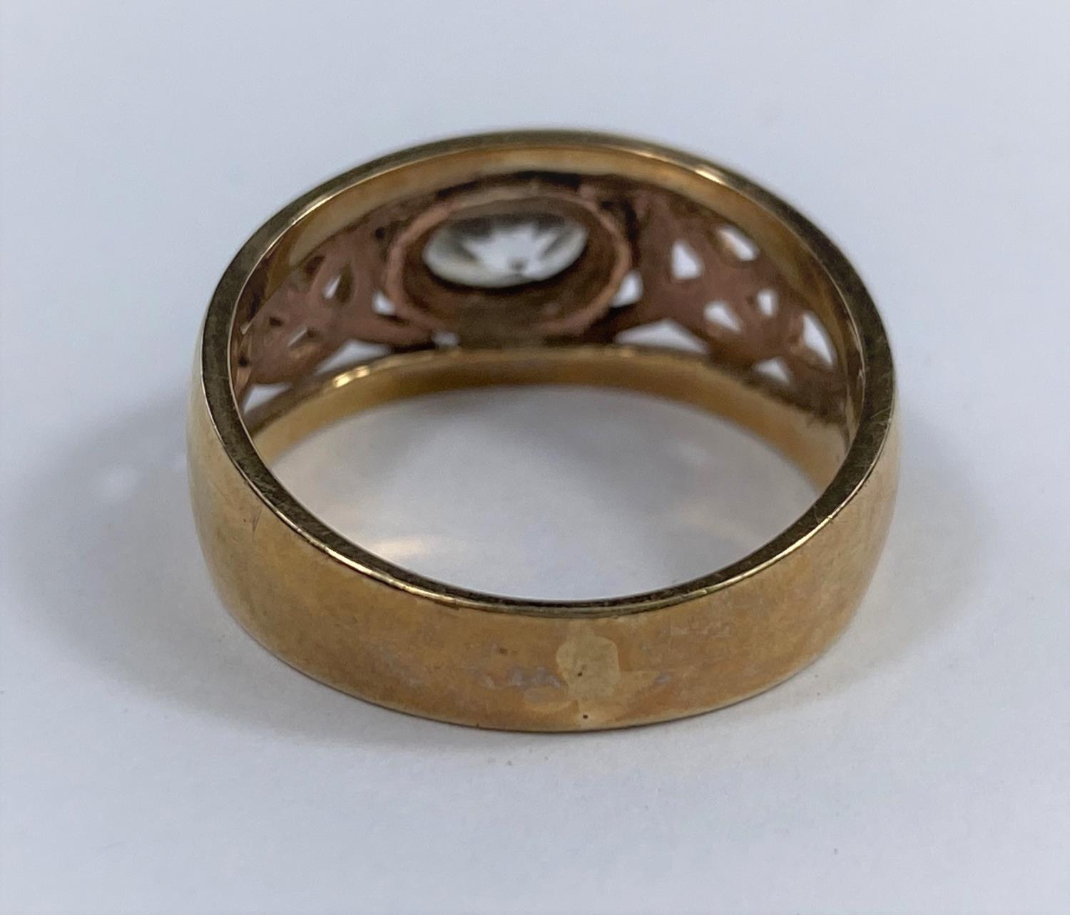 A 9 carat hallmarked gold period style ring set clear oval stone, the split shank with pierced - Image 4 of 5