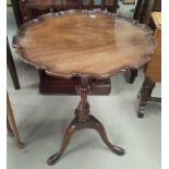 A Georgian style mahogany armchair; a reproduction mahogany wine table; a reproduction demi-lune