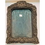 An ornately embossed photo frame, Birmingham 1903, height 30 cm (worn through in parts)