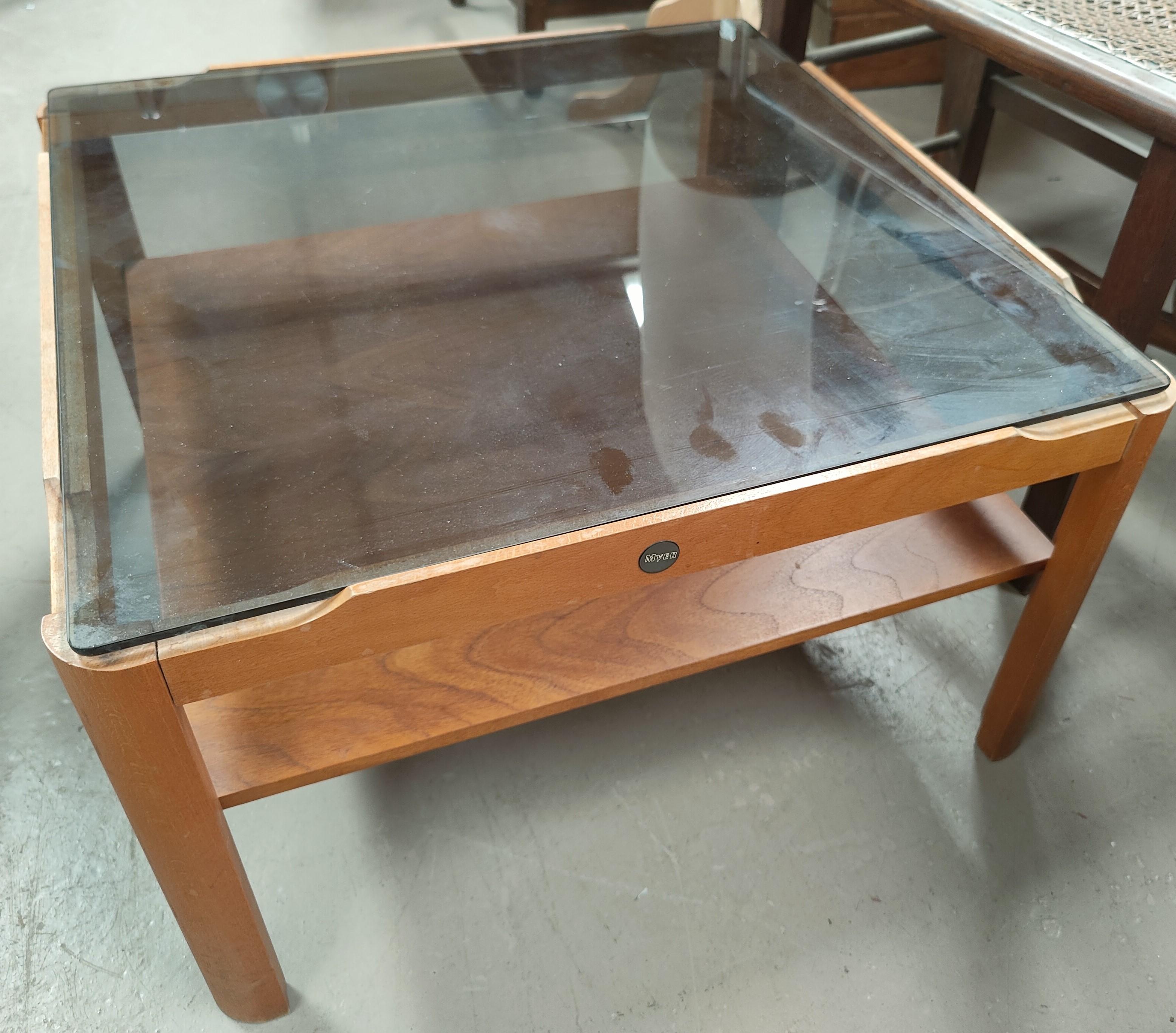 A teak mid century coffee table, a similar smokey glass teak coffee table