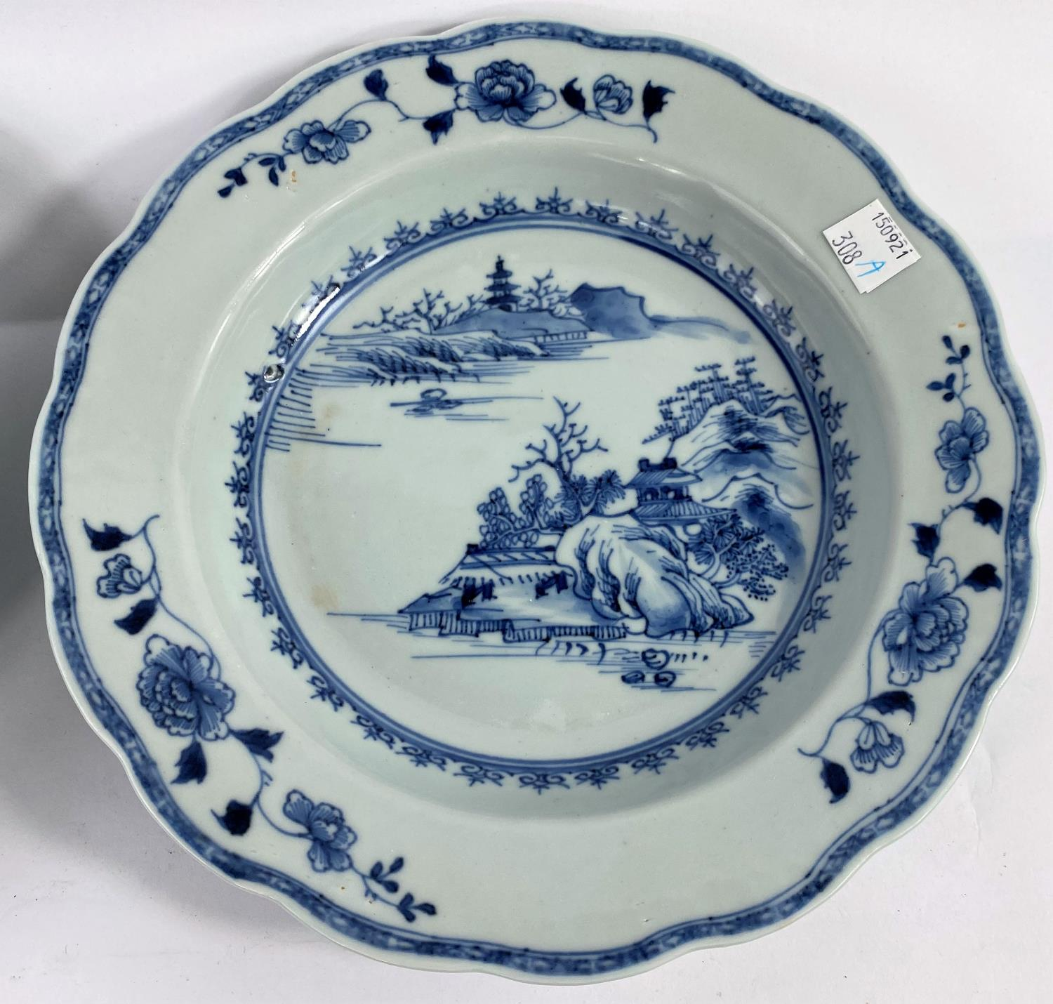 A pair of 18th century Chinese blue and white shallow dishes with traditional mountain scenes, - Image 3 of 6