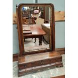 A Georgian style dressing table mirror in walnut free standing frame with drawers to base