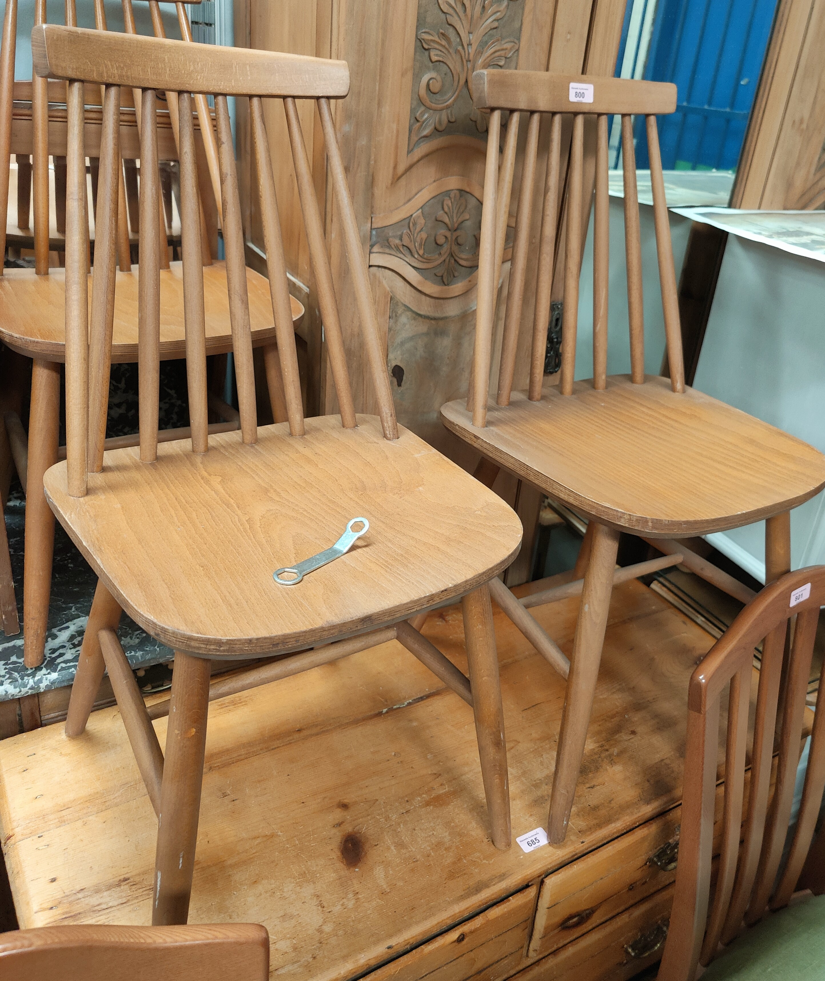 Four stick back dining chairs in the Ercol manner