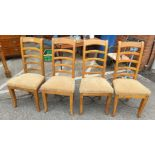 A modern lightwood set of four chairs.