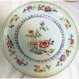 A Chinese 19th century plate with central polychrome floral arrangement and floral border and