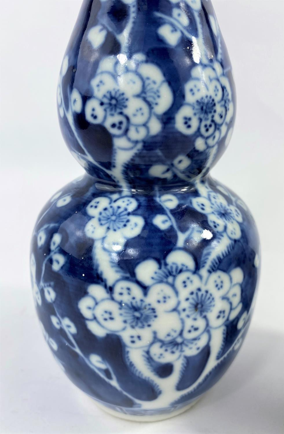 A 19th century Chinese blue and white double gourd vase, prunus blossom decoration, h. 19cm (rim a. - Image 3 of 7