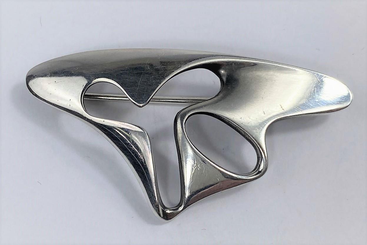 A Georg Jensen silver amoeba brooch designed by Henning Koppel, No 325, stamped marks, width 5.5 cm