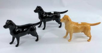 Three Beswick labrador dogs, two black and one yellow, number: 1548