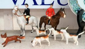 A Beswick hunting group: Huntsman 1501, Huntswoman 1730, a pack of four dogs and a fox